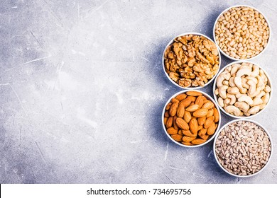 Assortment of nuts and seeds- sunflower seeds, pine nuts, cashew,walnut,almond. Top view ,space for text.