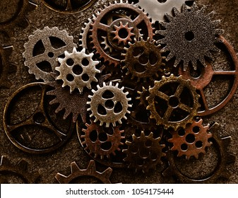 Assortment of old metal gears on grunge background