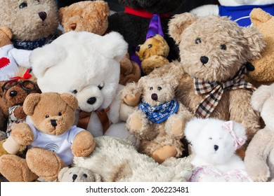 assortment of old teddies at flea market