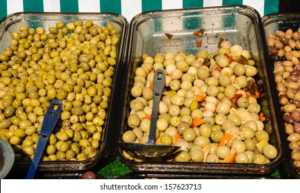 Assortment of olives on farmers market in Paris.