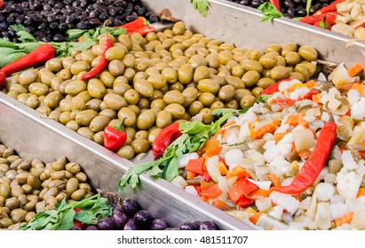 Assortment of olives and salads on market stand