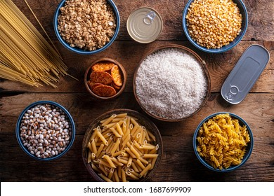 An assortment of pantry ingredients on a rustic wood table top.