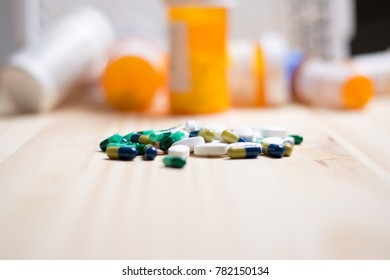 assortment of pharmacutical drugs with pill bottles in the background.