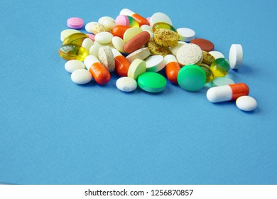 Assortment of pills, tablets and capsules on table