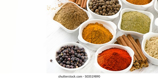 Assortment of powder spices in bowls. Selective focus