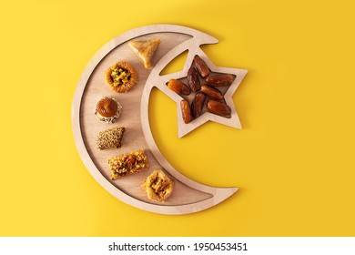 Assortment of Ramadan dessert baklava on yellow background