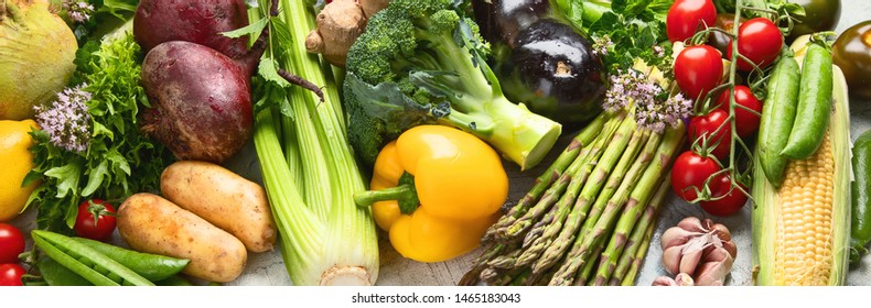 Assortment of raw organic vegetables. Detox diet. Healthy eating background. Vegan and vegetarian clean food concept. Panorama, banner