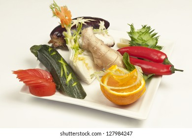Assortment of raw vegetables on white