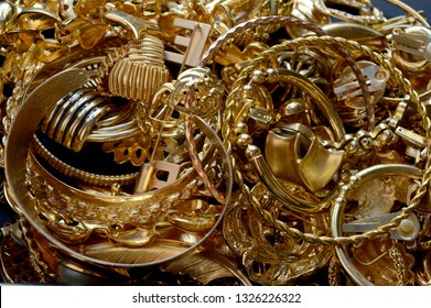 An assortment of recovered gold jewelry for further processing with aqua regia to get back pure gold bullion.