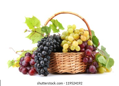 assortment of ripe sweet grapes in basket, isolated on white