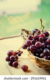 assortment of ripe sweet grapes in basket wooden background/Grapes in the basket/ Summer Wine Season