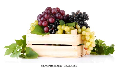 assortment of ripe sweet grapes in wooden crate, isolated on white