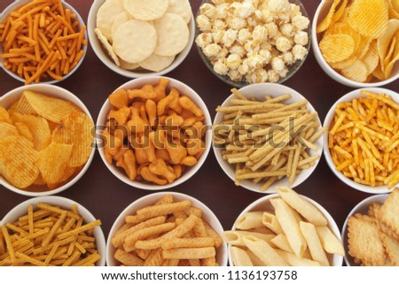 assortment-snackes-bowls-on-wooden-450w-