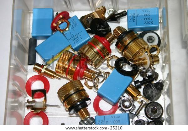 Assortment of speaker plugs, condensators and screws