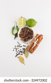Assortment of spice,Star anise in white bowl and cinnamon,bay leave,pepper corn,clove green pepper,lime fruit over white background