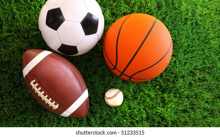 Assortment of sport balls on green grass