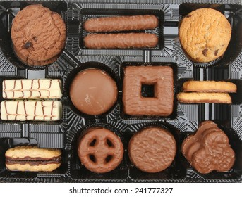 Assortment of sweet biscuits in a plastic tray