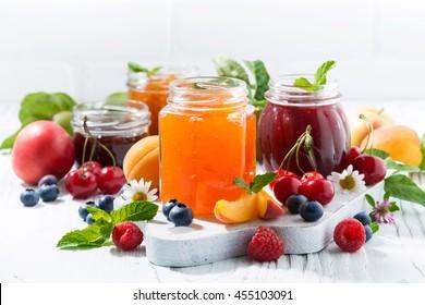 assortment of sweet jams and seasonal fruits, closeup