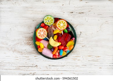Assortment of sweets and candies in bowls on table