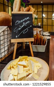 Assortment of tasty and delicious cheese selection antipasto delicatessen. Aged, Cheddar or Gouda and Camembert or Brie on a wooden board. A perfect appetizer, party snack or good accompany with wine.