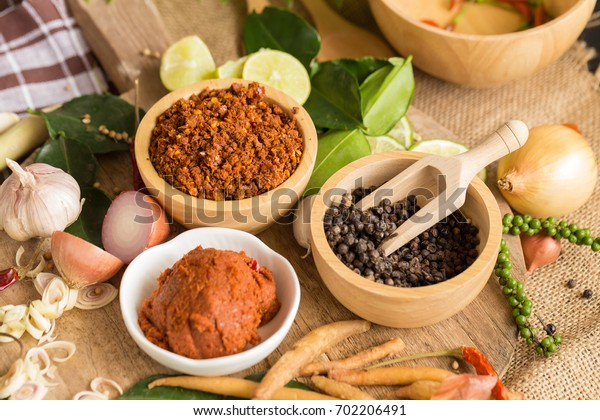 Assortment of Thai food Cooking ingredients. Spices ingredients chilli pepper garlicgalanga and kaffir lime leaves.