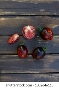 assortment of tomatoes on brown wooden surface