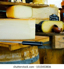 assortment of tomme of ewes sold in market in provence,france-with text ewes milk