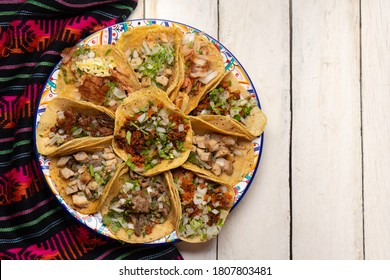 Assortment of traditional mexican tacos on white background