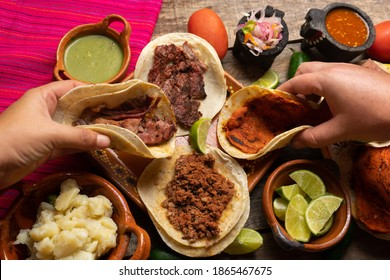 Assortment of traditional mexican tacos on wooden background