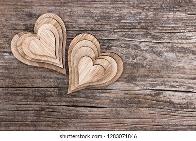Assortment of two heart pyramids on a wooden background