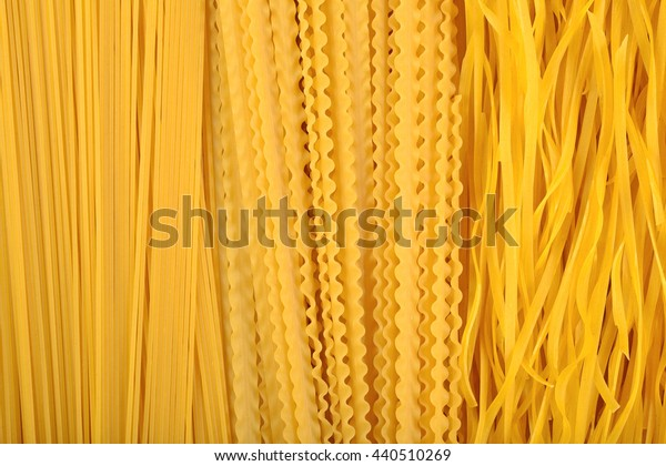 Assortment of uncooked Italian pasta as background texture