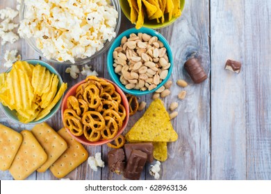 Assortment of unhealthy snacks. Diet or weight control concept. Space for text