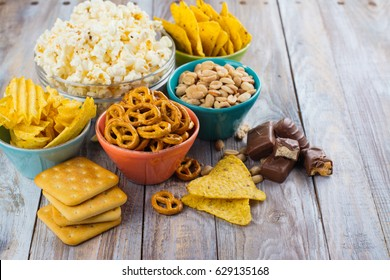 Assortment of unhealthy snacks. Diet or weight control concept. Space for text - Shutterstock ID 629135168