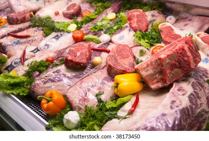 Assortment of U.S. export meat. Some veterinary service  stamps are visible, trademarks blurred