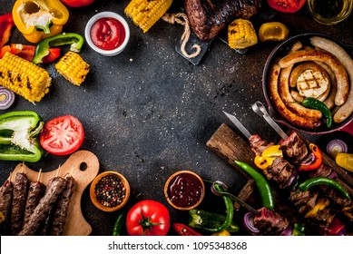Assortment various barbecue food grill meat, bbq party fest - shish kebab, sausages, grilled meat fillet, fresh vegetables, sauces, spices, dark rusty concrete table, above copy space