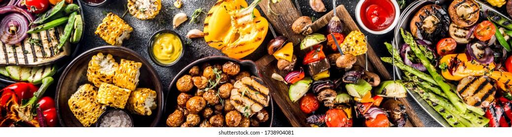 Assortment various barbecue vegan food, set of grill veggies, vegetable bbq party fest, grilled corn, vegan skewers kebabs, hot vegetable salad, with sauces & spices. Vegetarian seasonal summer food