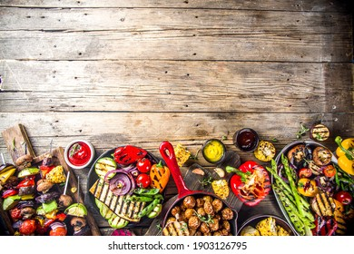 Assortment various barbecue vegan food, set of grill veggies, vegetable bbq party fest, grilled corn, vegan skewers kebabs, hot vegetable salad, with sauces spices. Vegetarian seasonal summer food