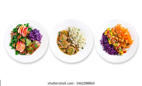 Assortment of various healthy keto paleo meals on white plate. Top view. Isolated. Space for text.