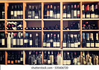 assortment of wine bottle on shelves in retail wine house