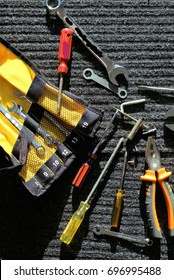 Assortment Worker's tools on gray-black work mat