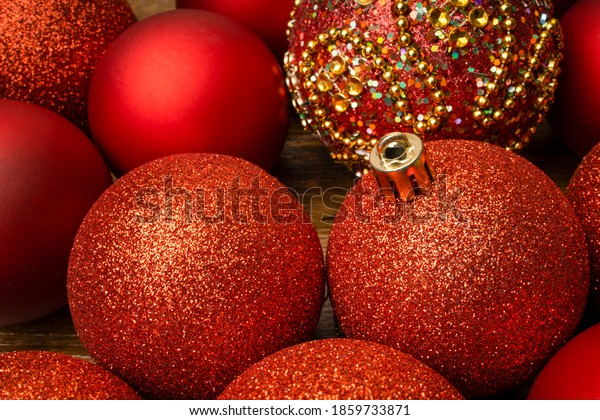 Assortments of red Christmas ornamental baubles closeup.