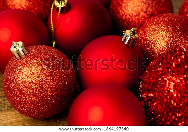 Assortments of red Christmas ornamental baubles, closeup.