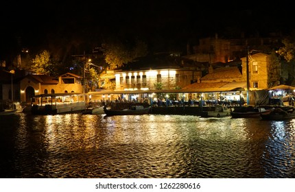 Assos ancient harbour at night.