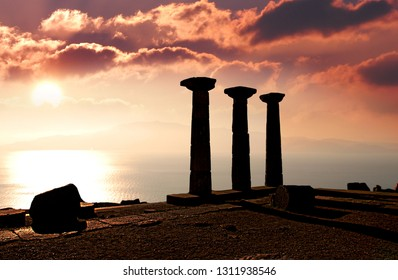 Assos Athena temple with sunset background