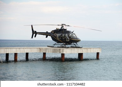 ASSOS, CANAKKALE, TURKEY JUNE,21 2018, TC-HLN Bell 407 Model Helicopter  Located on the pier