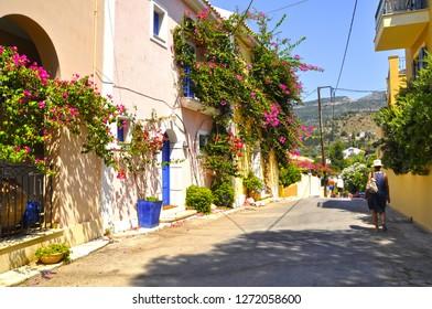 Assos, Kefalonia, Greece. Colorful houses on street.