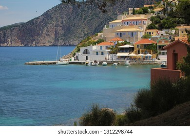 Assos, Kefalonia, Greece. Colorful houses of Assos village and beautiful turquoise sea. Assos is a popular holiday destination on the tourists on Ionian island of Kefalonia.