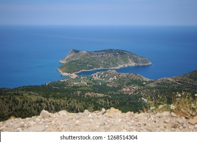 Assos, Kefalonia, Greece. View from cliff to the peninsula, village Assos and beautiful blue sea. Assos is a popular holiday destination on the Tourists on Ionian island of Kefalonia.