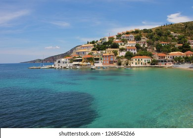 Assos, Kefalonia, Greece. View of colorful houses of Assos village and beautiful turquoise sea. Assos is a popular holiday destination on the tourists on Ionian island of Kefalonia.