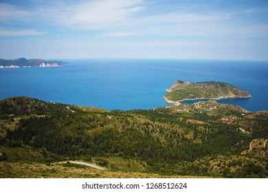 Assos, Kefalonia, Greece. View of the peninsula, village Assos and beautiful blue sea. Assos is a popular holiday destination on the Tourists on Ionian island of Kefalonia.